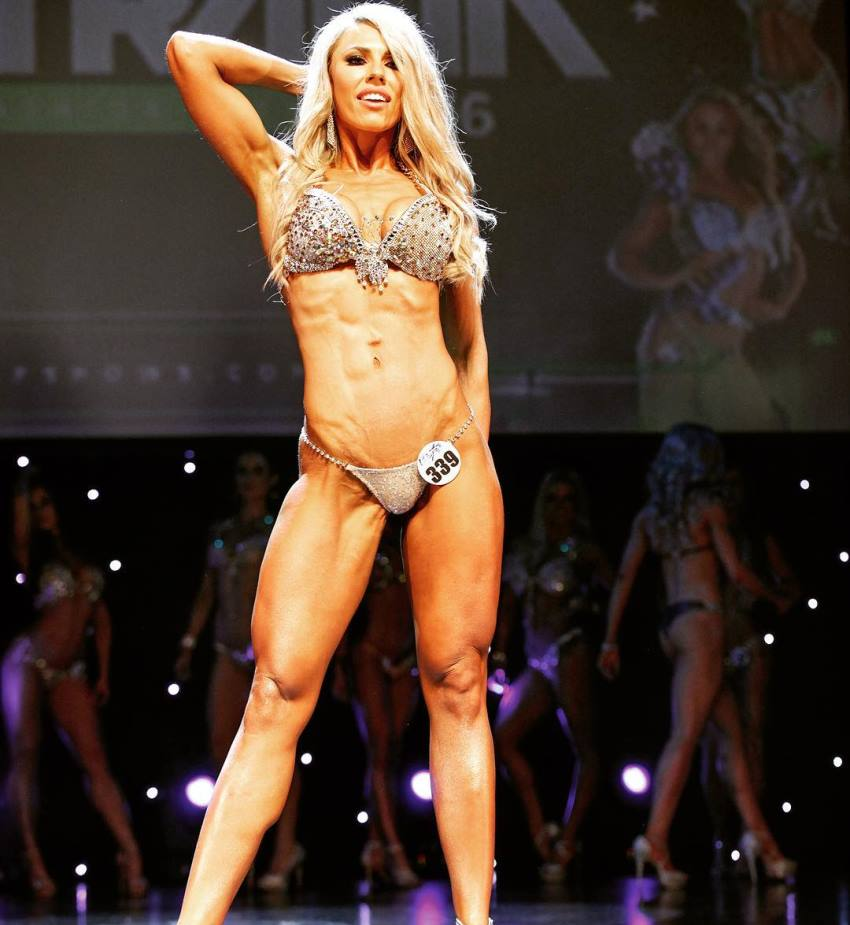 Lucinda Keily standing on the WBFF bikini stage, confident in her posing