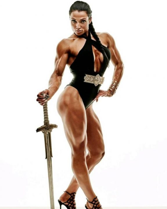 Mariana Mayakonda posing for a photoshoot with a sword in her hand, looking ripped and aesthetic