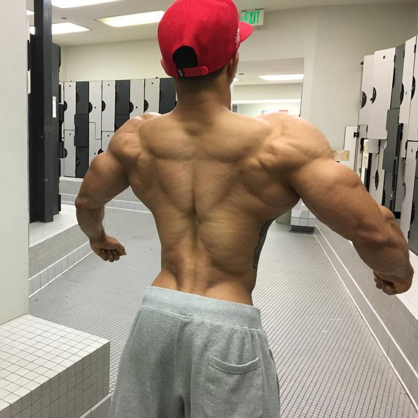 Marvin Moss III flaring his lats and arms wide to show his ripped and muscular back