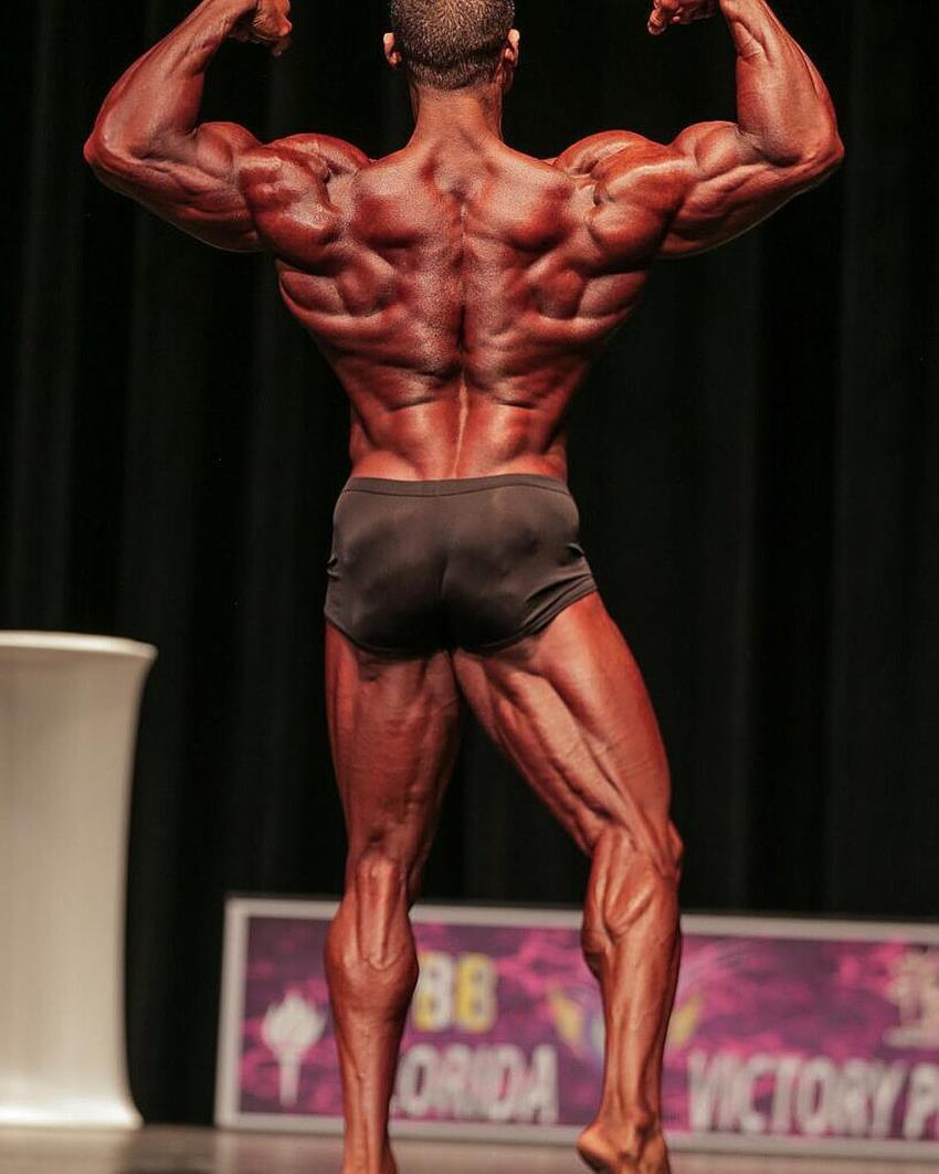 Robert Galva doing a back double biceps pose in a classic physique contest