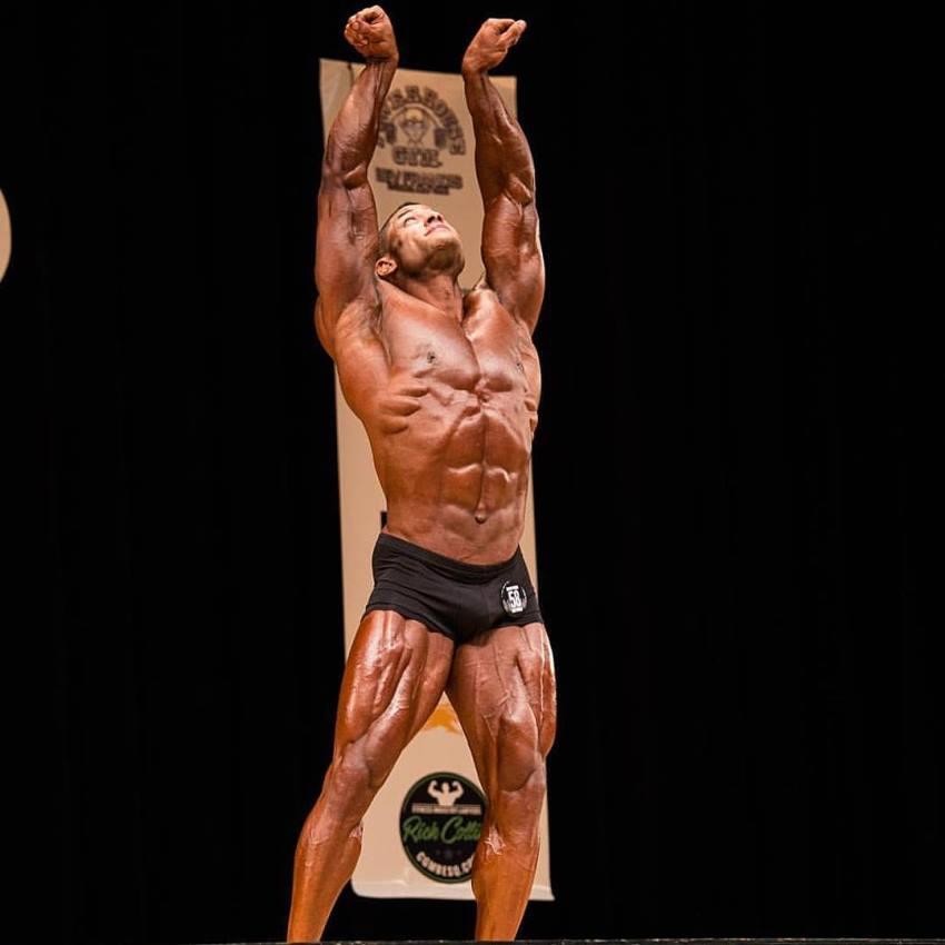 Robert Galva posing in a classic physique contest