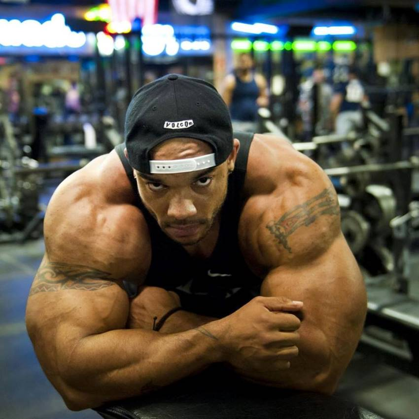 Sergio Oliva Jr leaning against a bench in the gym