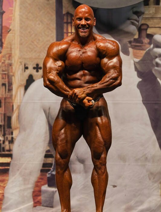 Stan Efferding posing on the bodybuilding stage