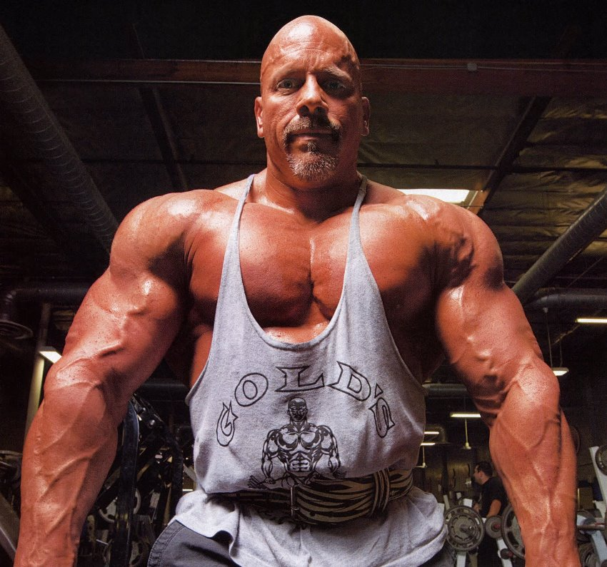 Stan Efferding in a white tank top, looking big and aesthetic