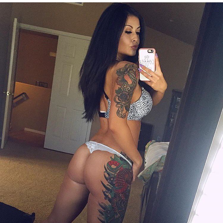 Teresa Wimbs taking a selfie of her amazing tattooed legs and glutes