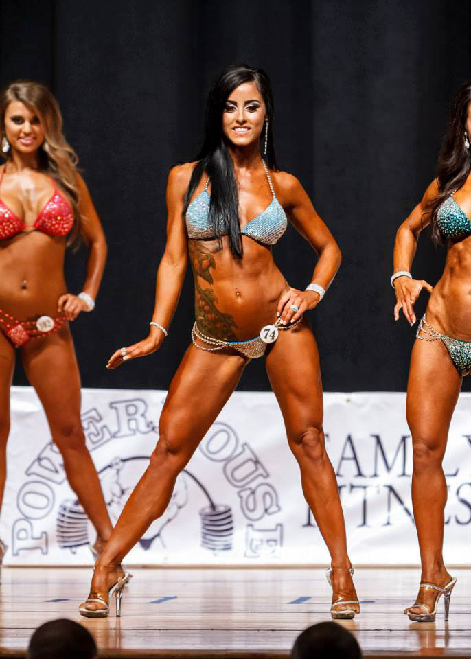 Alysia Macedo on stage at a bikini competition.