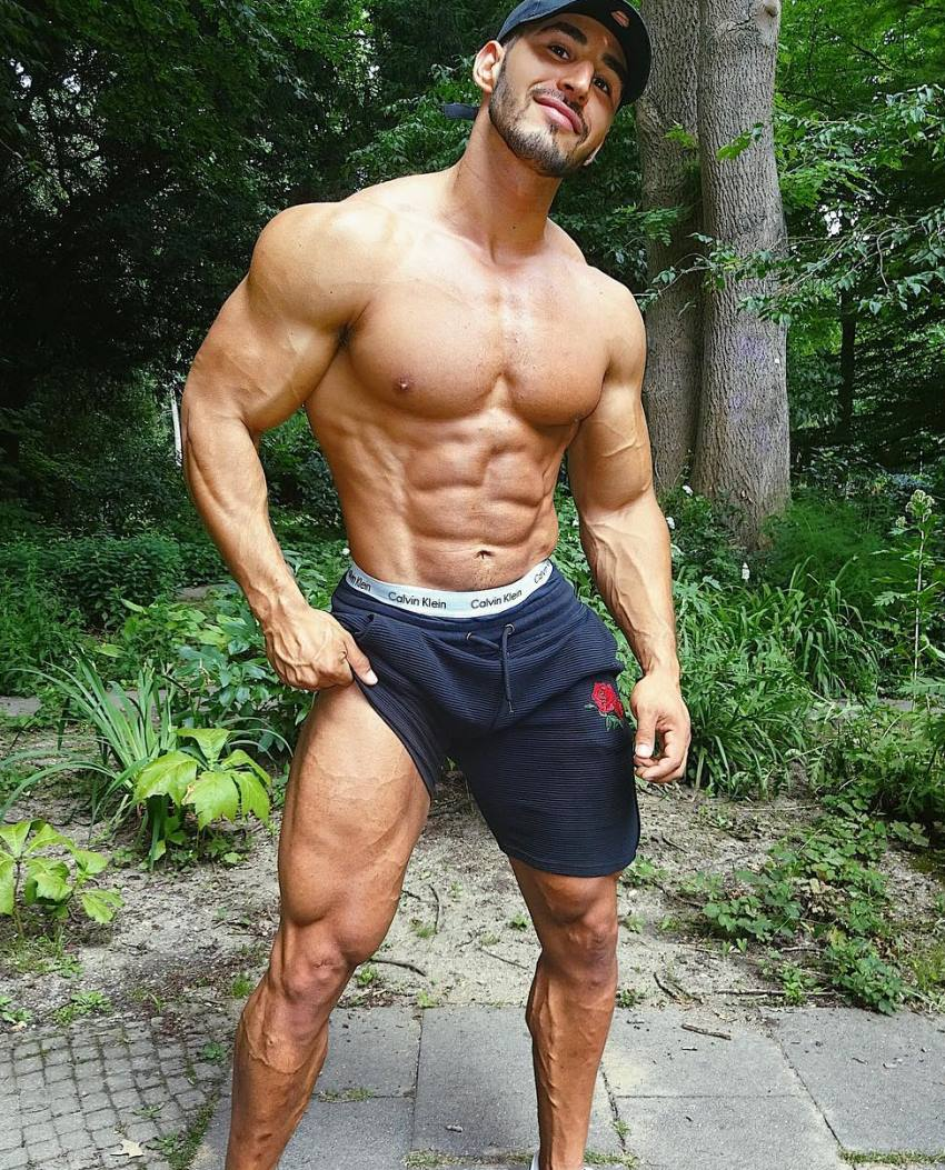 Amin Elkach showing off his abs, arms, chest, and legs