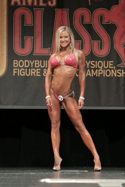 Amy Updike on stage at a bikini competition.