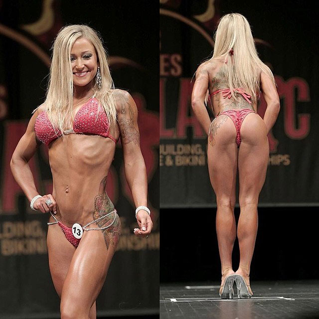 Amy Updike on stage showing off her physique on stage.