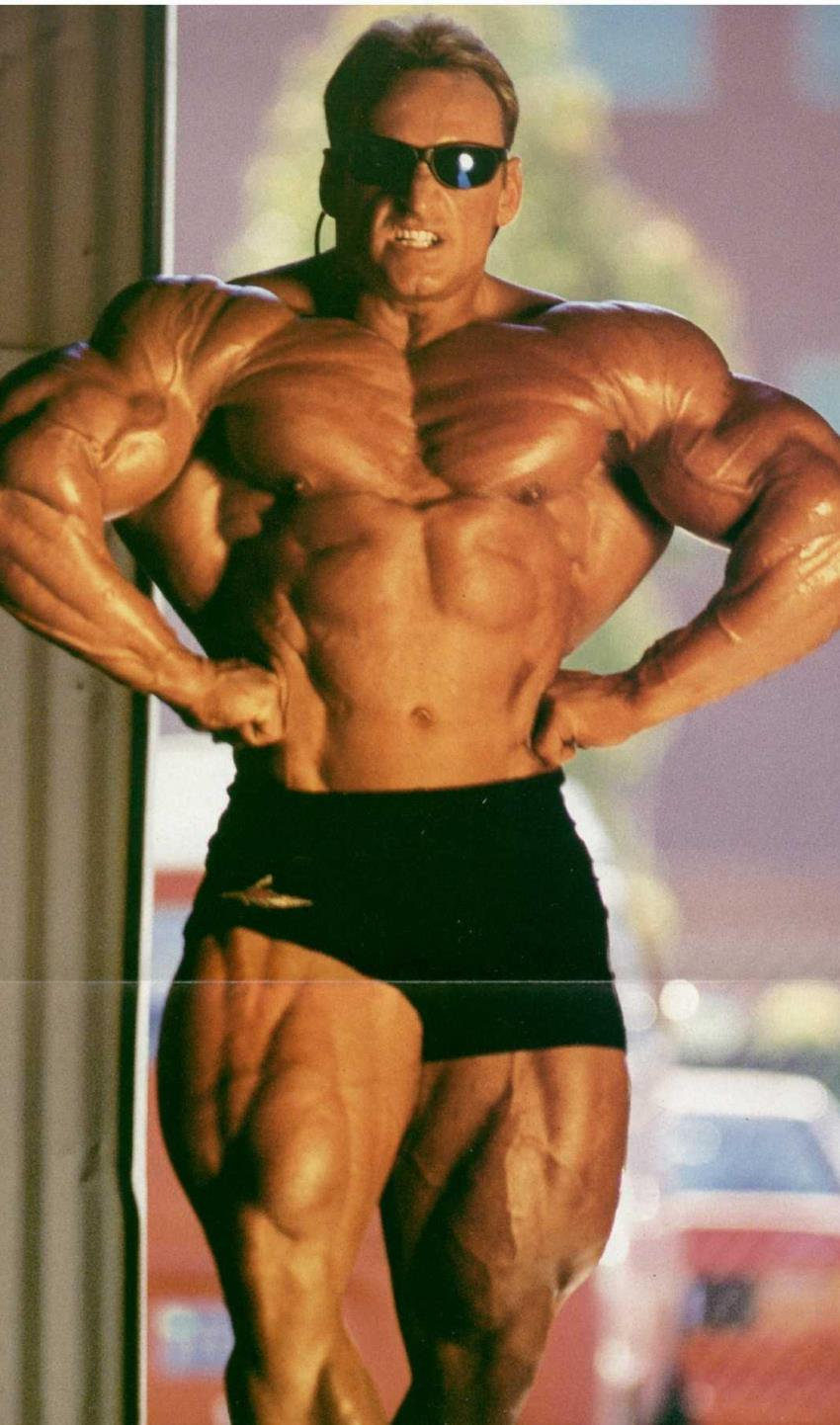 Andreas Munzer flexing his lats for the camera