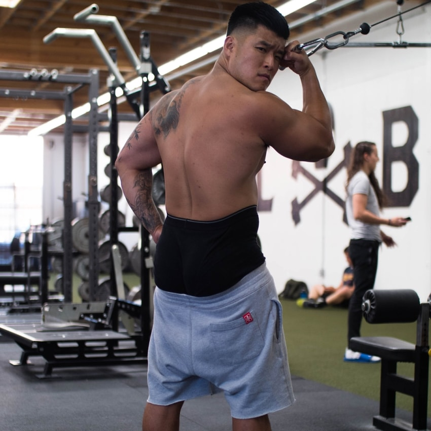 Bart Kwan showing his fit back muscles
