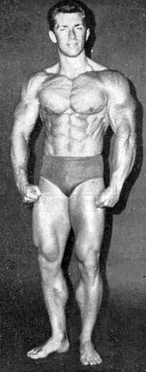 Bob Gajda flexing his chest, abs, arms, and legs for the camera