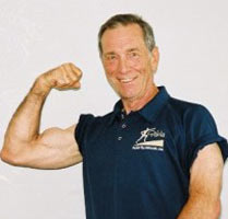 Bob Gajda in his older days, flexing his biceps