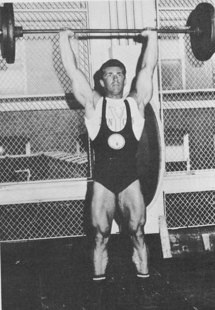Bob Gajda doing an overhead press