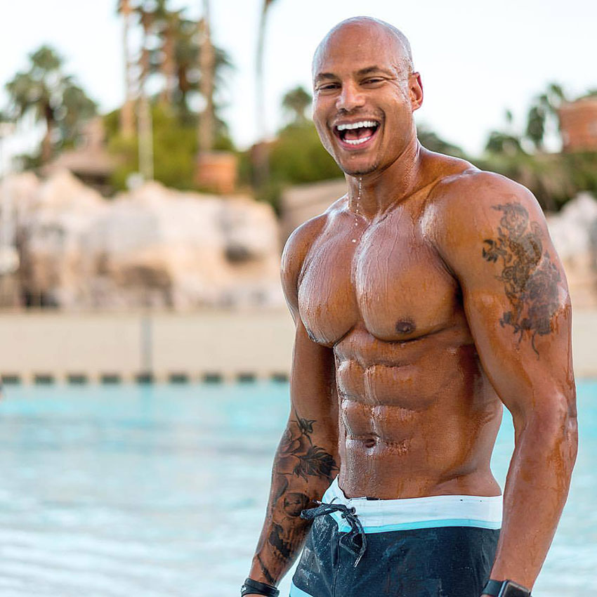 Brandon Carter stood in a swimming pool in a photo shoot.