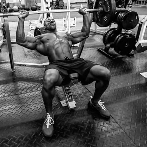 Coty Hart doing heavy bench press shirtless