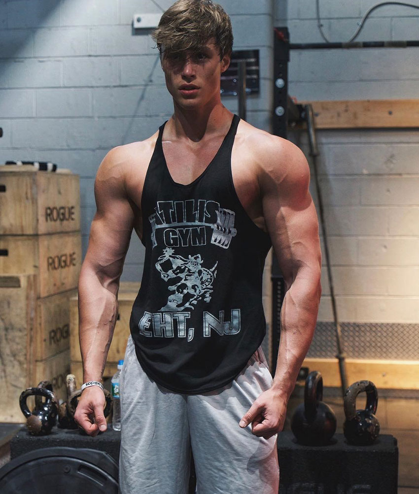 David Laid wearing a stringer vest in a photo shoot.