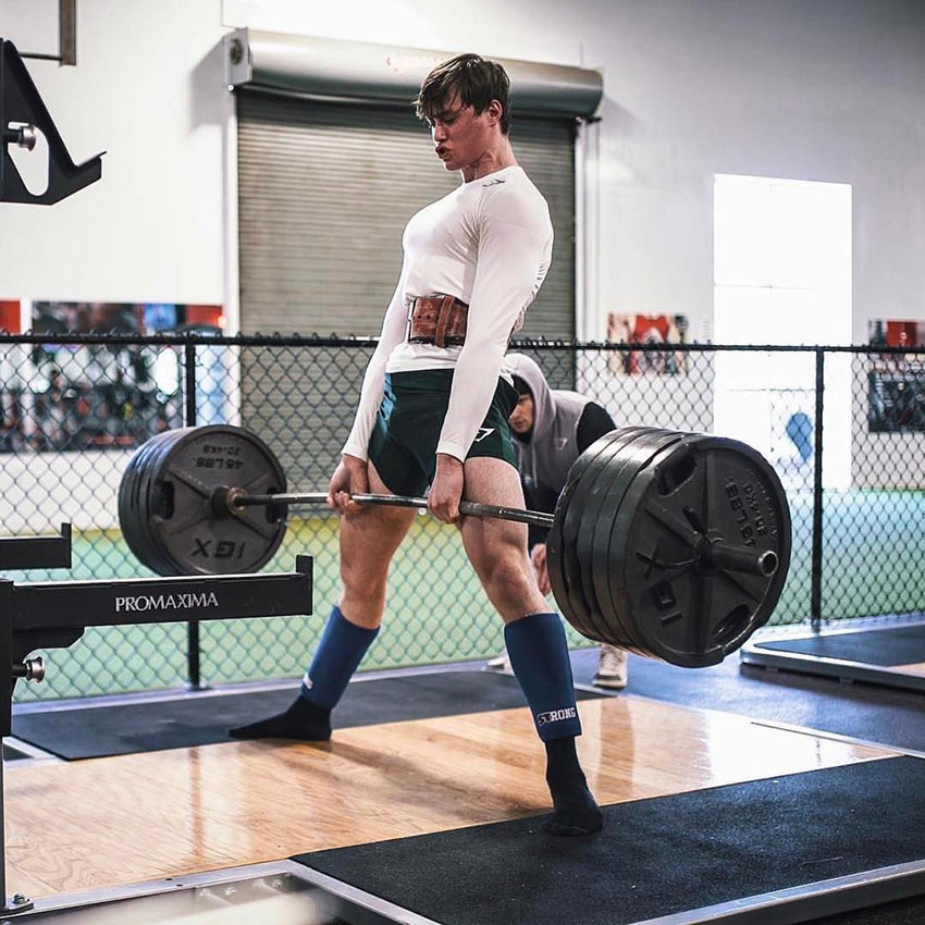 David Laid performing deadlifts in the gym.