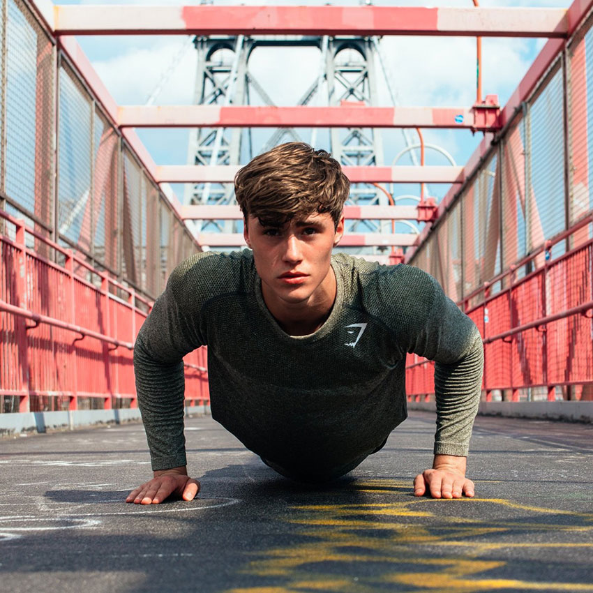 David Laid performing push ups in a photo shoot.