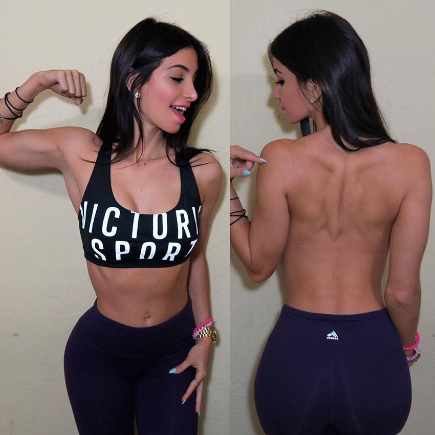 Diana Ruiz flexing her arm, and showing off her back.