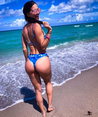 Diana Ruiz on the beach showing off her booty.