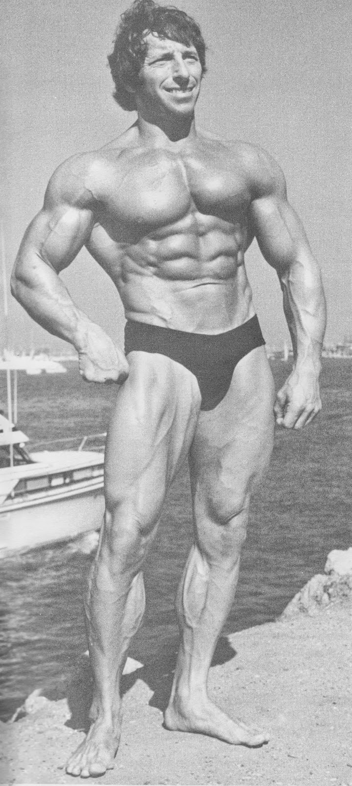 Eddie Giuliani posing for a photo showing off his muscular physique