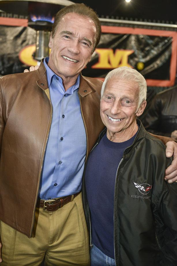 Eddie Giuliani taking a photo with Arnold Schwarzenegger