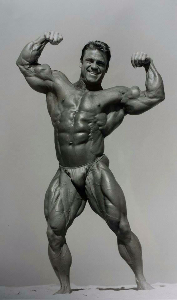 Eddie Robinson flexing in a photo shoot.