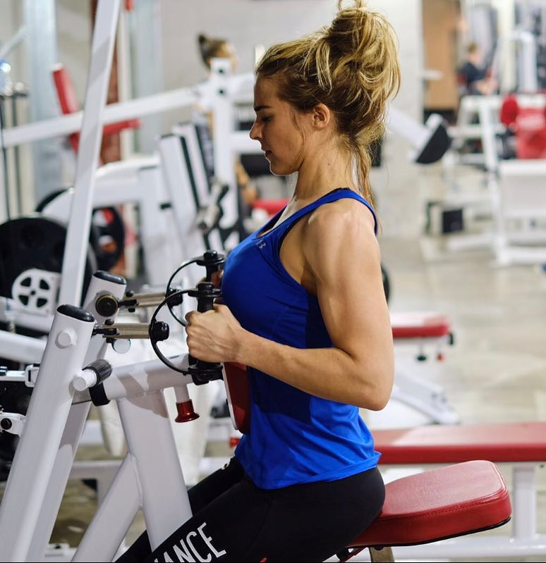 Gemma Atkinson doing a back exercise in the gym