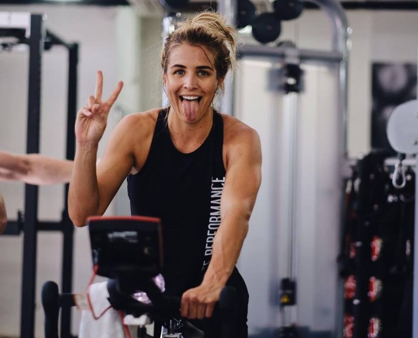 Gemma Atkinson showing peace sign and smiling with a tongue out