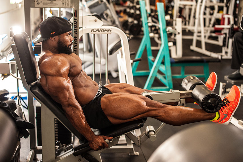 Gerald Williams performing leg extensions.