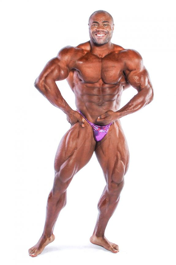 Gerald Williams showing off his physique in posing trunks.