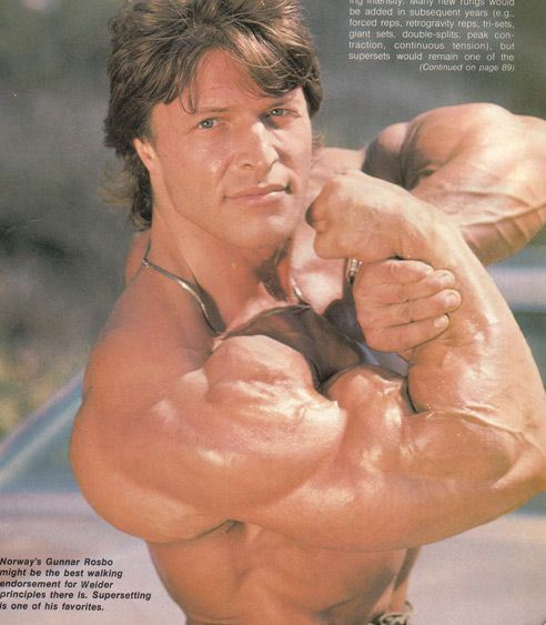 Gunnar Rosbo flexing his massive arms and shoulders