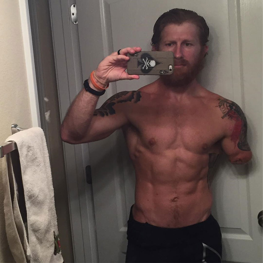 Jared Bullock taking a selfie in his bathroom showing his pre-competition body.