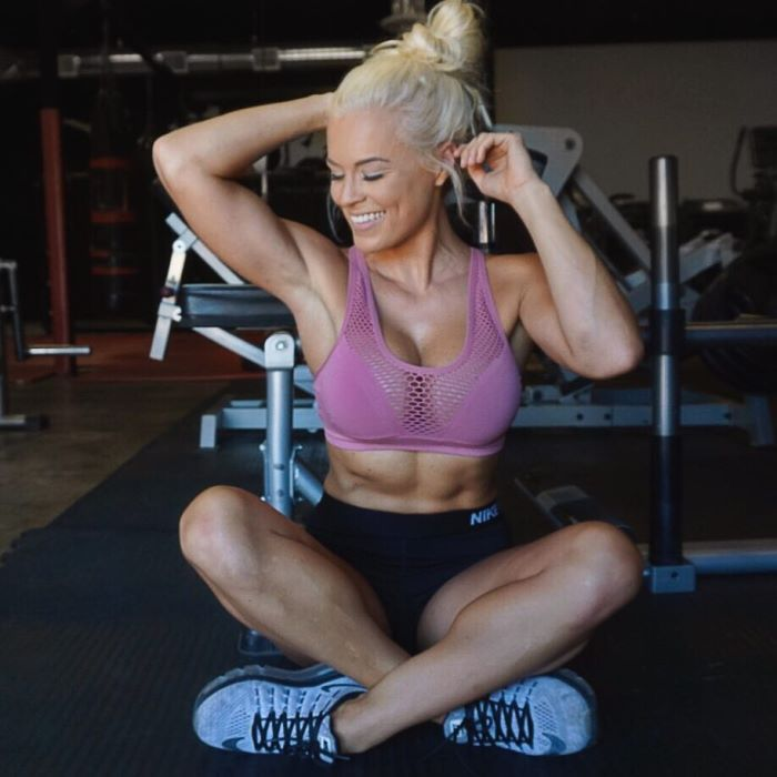 Jen Heward sitting down cross legged and showing her fit body