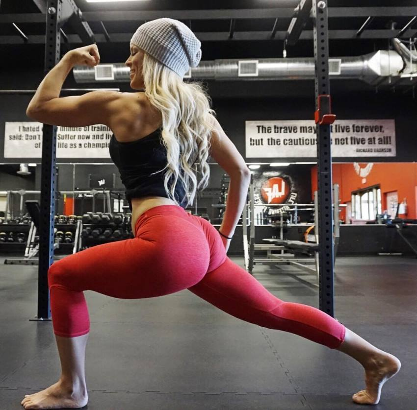 Jen Heward flexing her biceps and showing her awesome glutes in red leggings