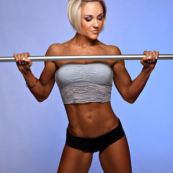 Jessie Hilgenburg holding onto a bar in a photo shoot.