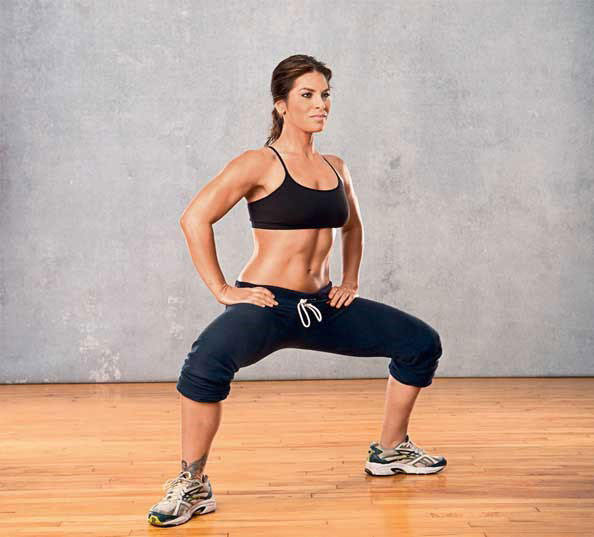 Jillian Michaels posing in a squat position.