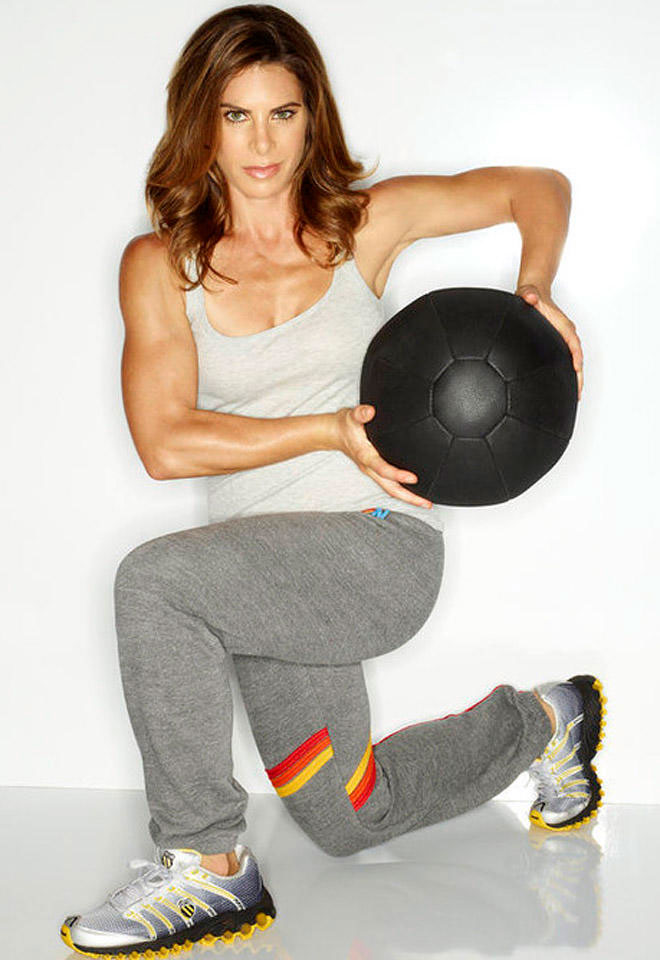 Jillian Michaels holding a medicine ball.
