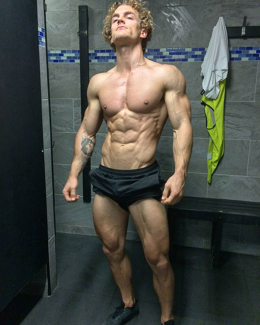 Joe Delaney showing off his physique in the gym.