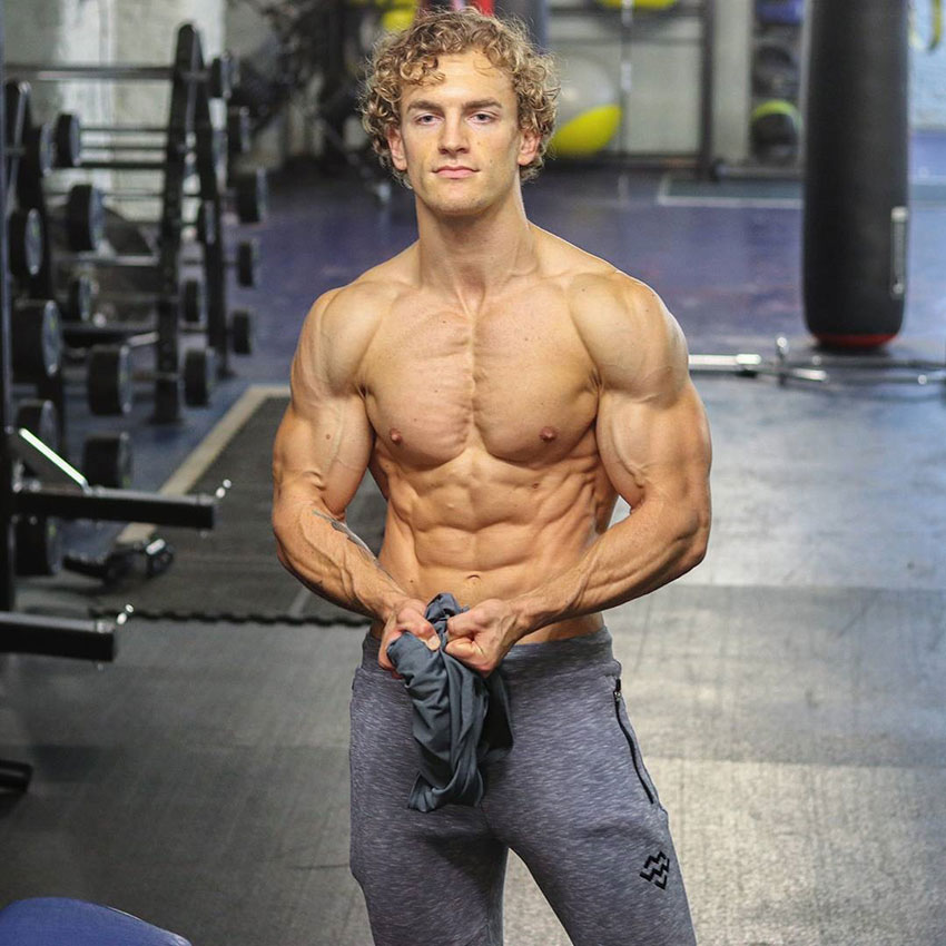 Joe Delaney showing off his shredded body in the gym.