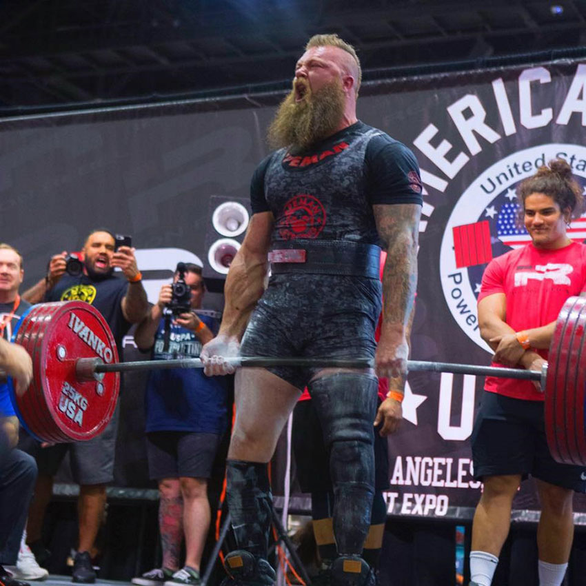KC Mitchell performing a deadlift in a competition.