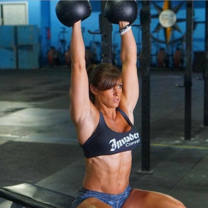 Kristen Graham doing an exercise while sitting on a bench