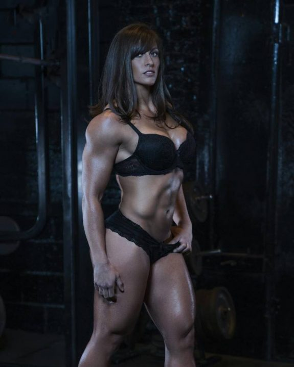 Kristen Graham posing for a phtoo shoot, showing her ripped physique