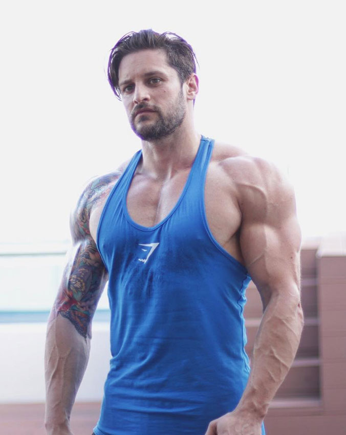 Lex Griffin in a photo shoot wearing a gym vest.