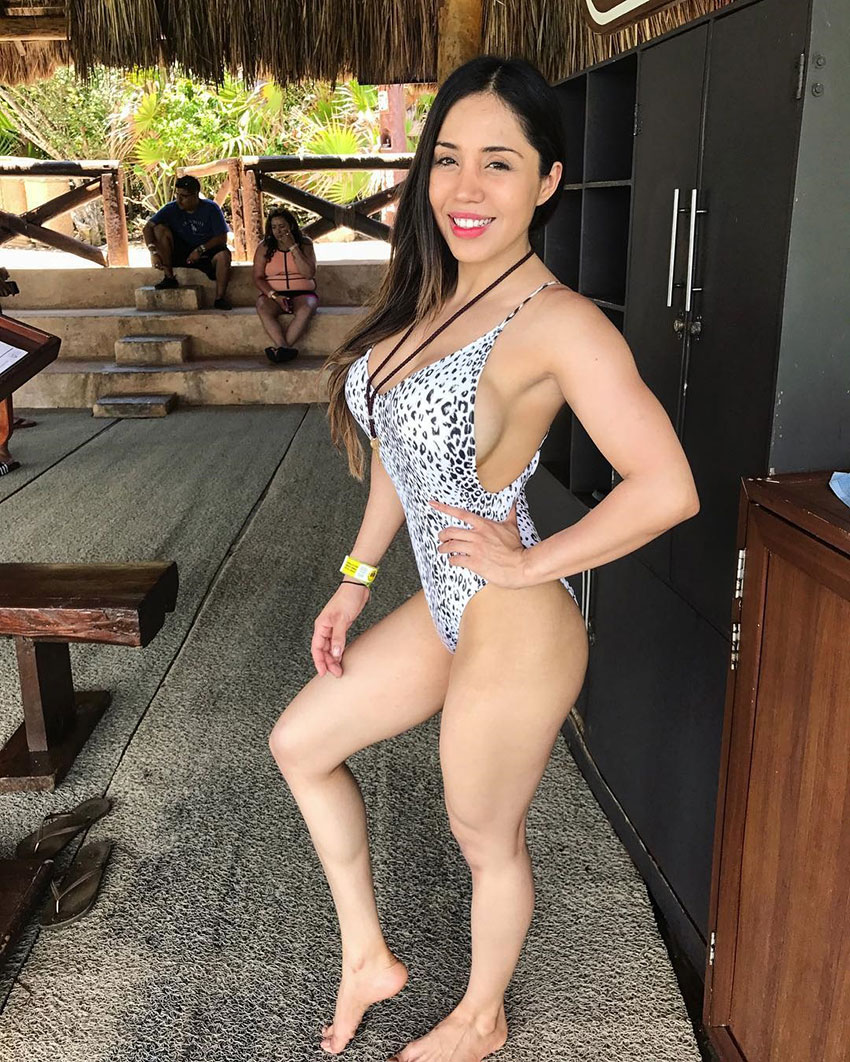 Liz Calles posing in a swimsuit.
