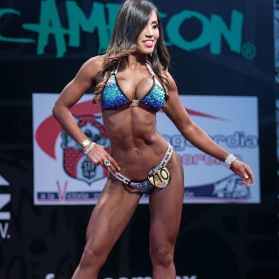Liz Calles on stage at a bikini competition.