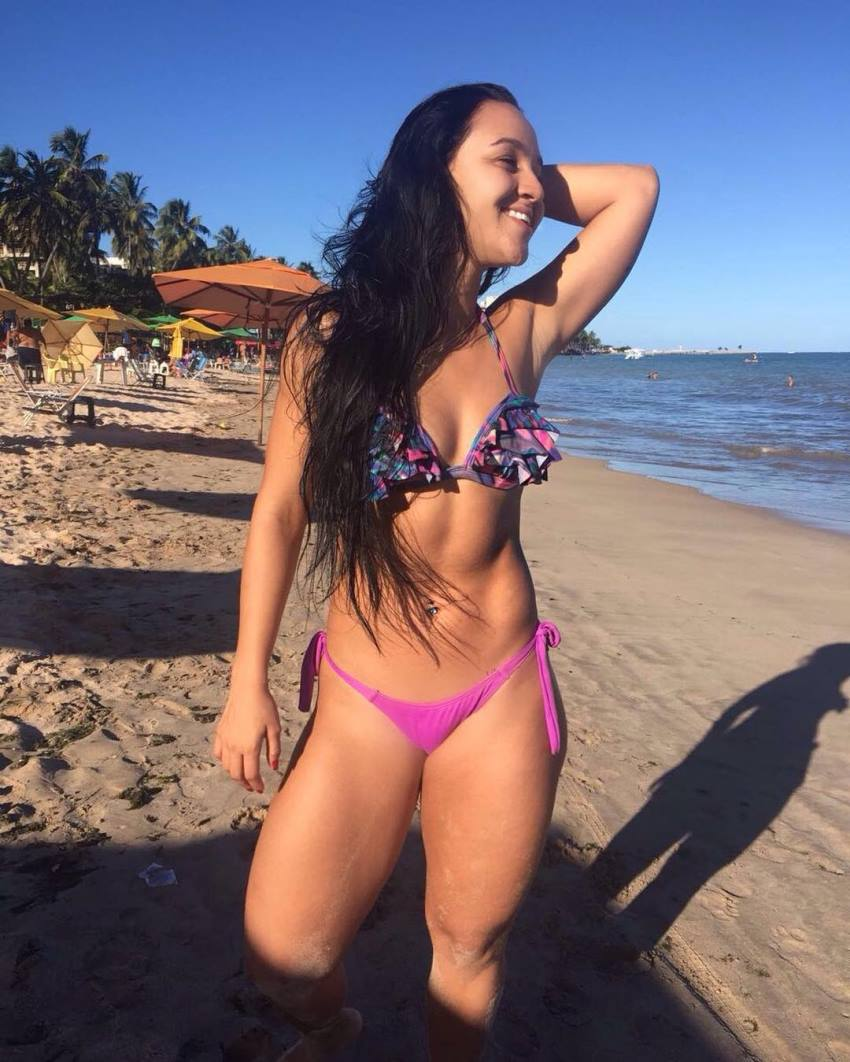 Lorrane Ottoni enjoying the sun on the beach, looking fit and healthy