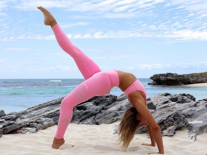 Madalin Giorgetta Frodsham doing yoga by the beach