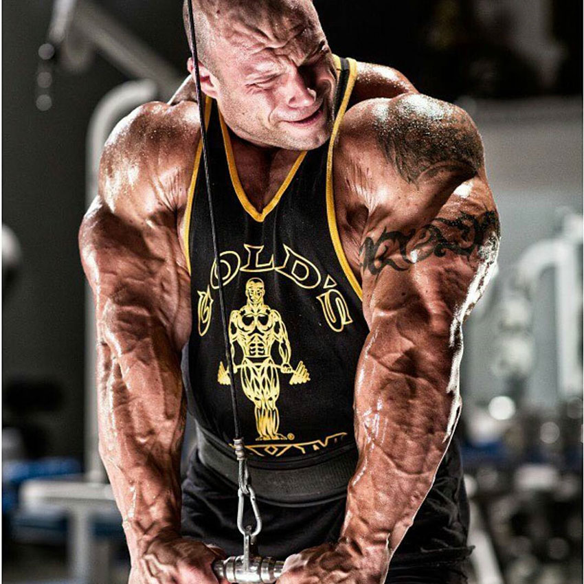 Morgan Aste performing tricep pushdowns.